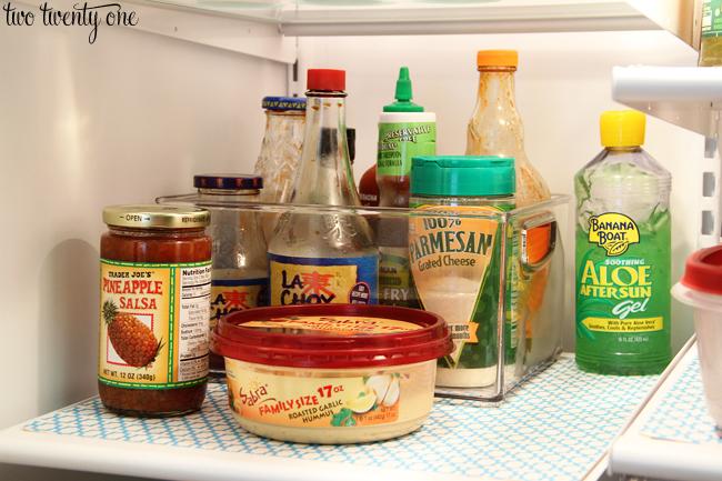 organizing condiments in fridge