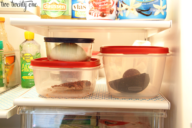 organizing leftovers in fridge