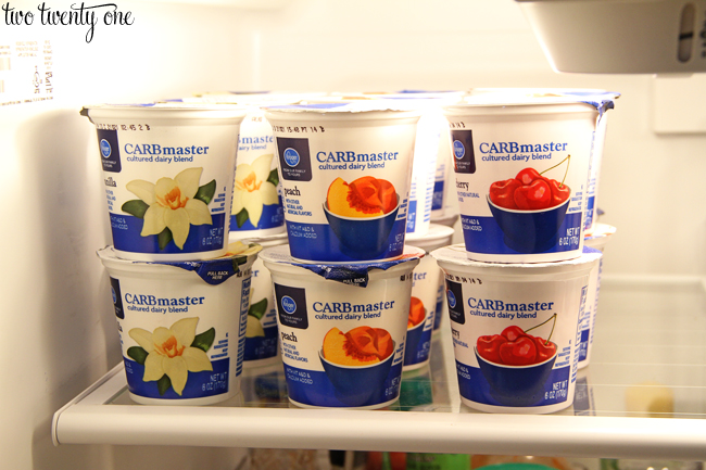 organizing yogurt in fridge