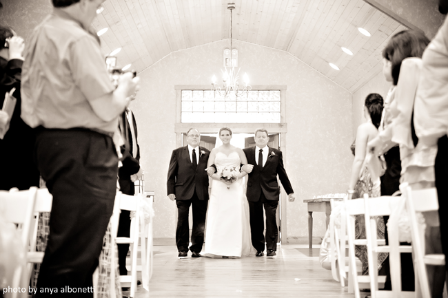 bride with two dads walking down aisle