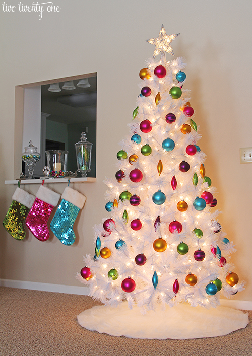 White Christmas tree with jewel tone ornaments