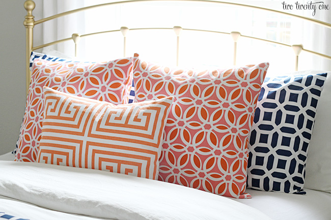 coral and navy pillows. Guest Bedroom Makeover Reveal