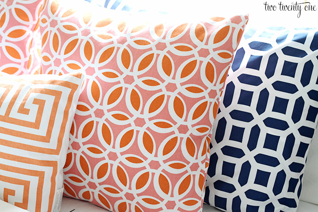 coral orange and navy pillows