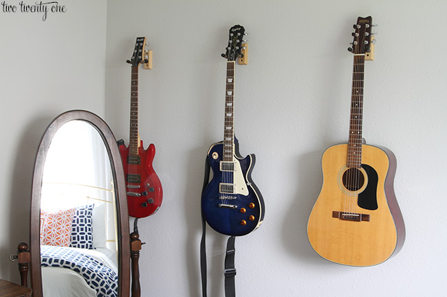 hanging guitars on a wall