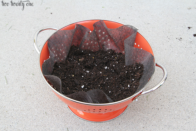 making a colander flower planter