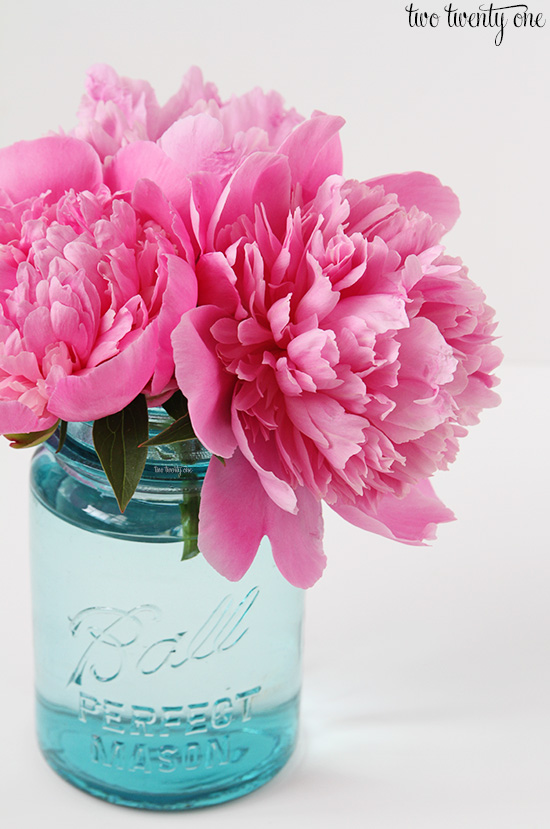 pink peonies in blue mason jar