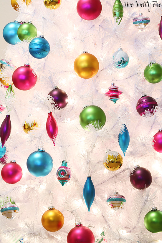 colorful ornaments on white christmas tree