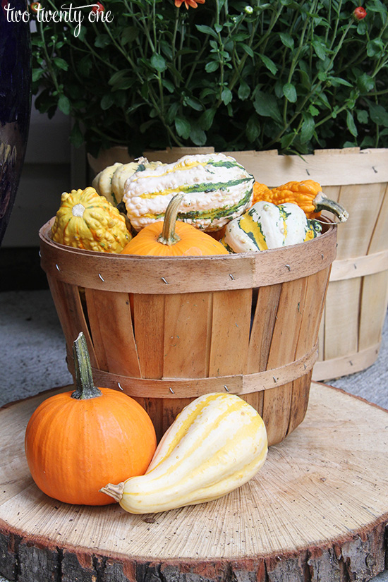 apple basket with gourds