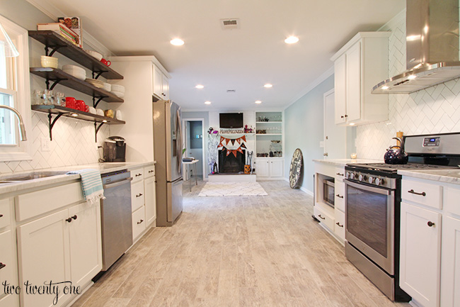 white kitchen with sitting area