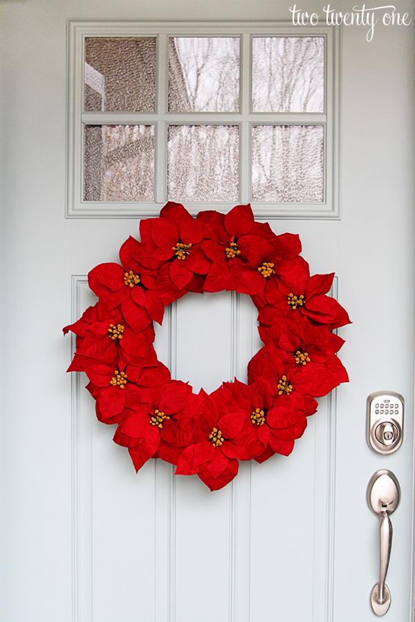 poinsettia wreath on door