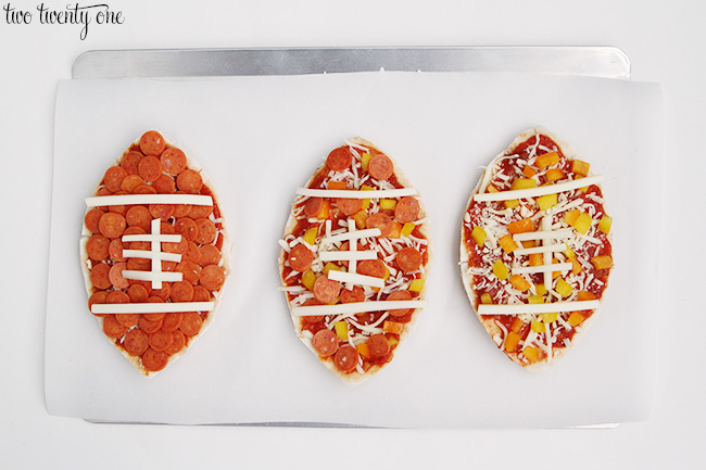 pita pizzas shaped like footballs