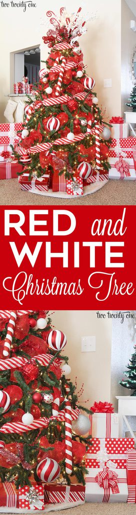 beautifully decorated red and white christmas tree with candy cane accents