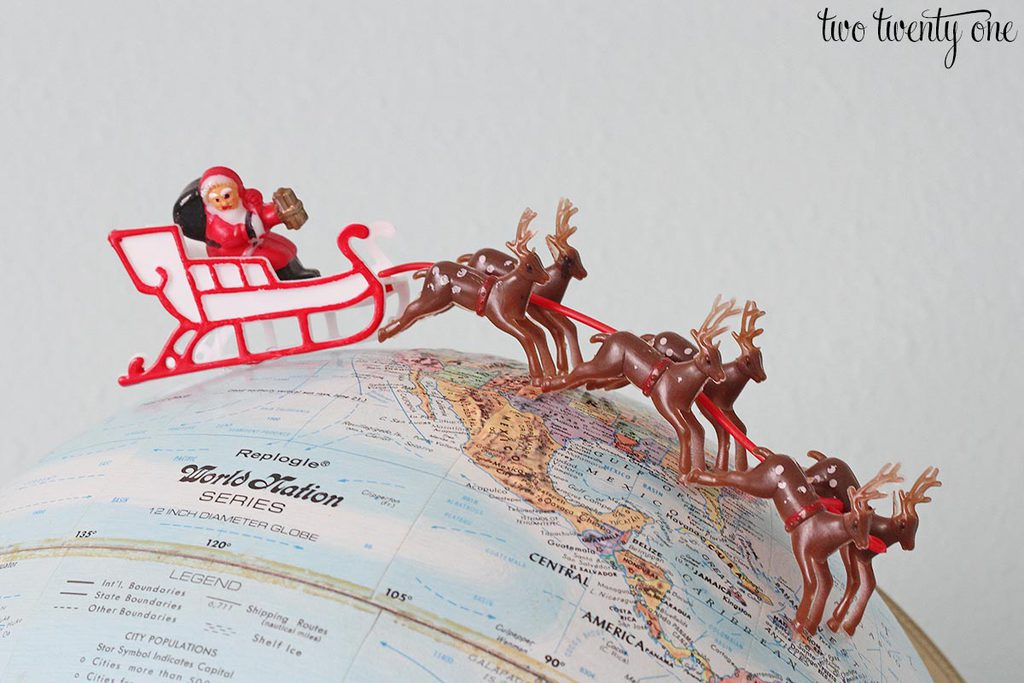 santa-and-reindeer-on-globe