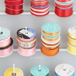 Home office / craft room update. How to store and neatly organize ribbon. Tip for storing gift wrap paper, and where to buy quality wrapping paper.