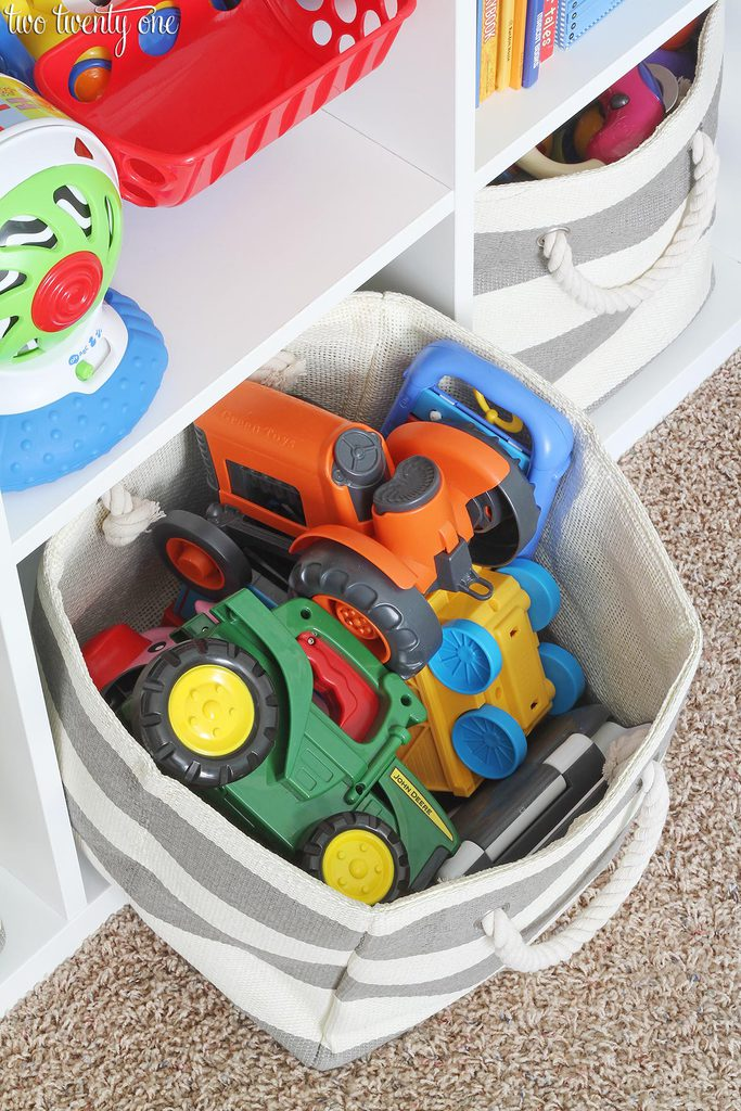This organized toddler closet features storage for clothing, toys, books, diapers, and other items. Great ideas for organizing for a child's closet.