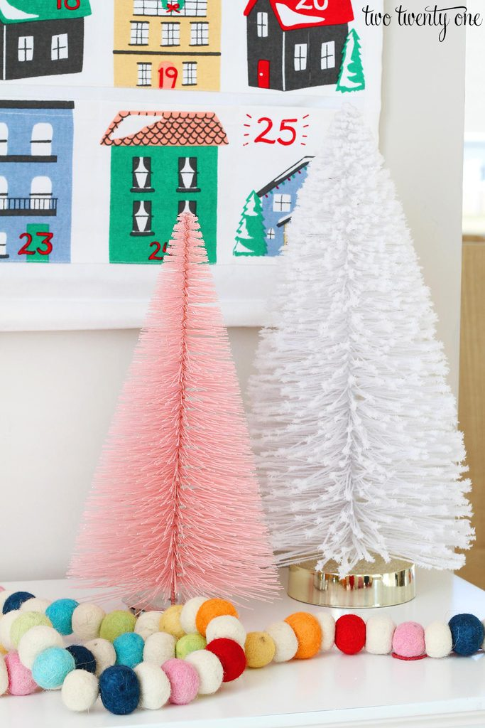 this specific multi colored pom pom garland is from michaels but its sold out in most places i shouldve bought more heres a look a like though - Michaels Christmas Garland