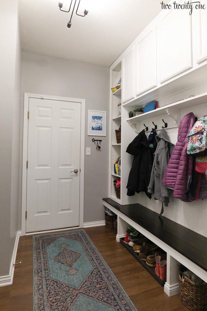 mudroom with white door