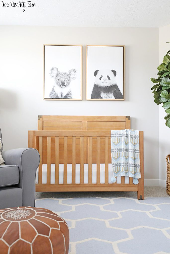 baby boy crib with wall art above