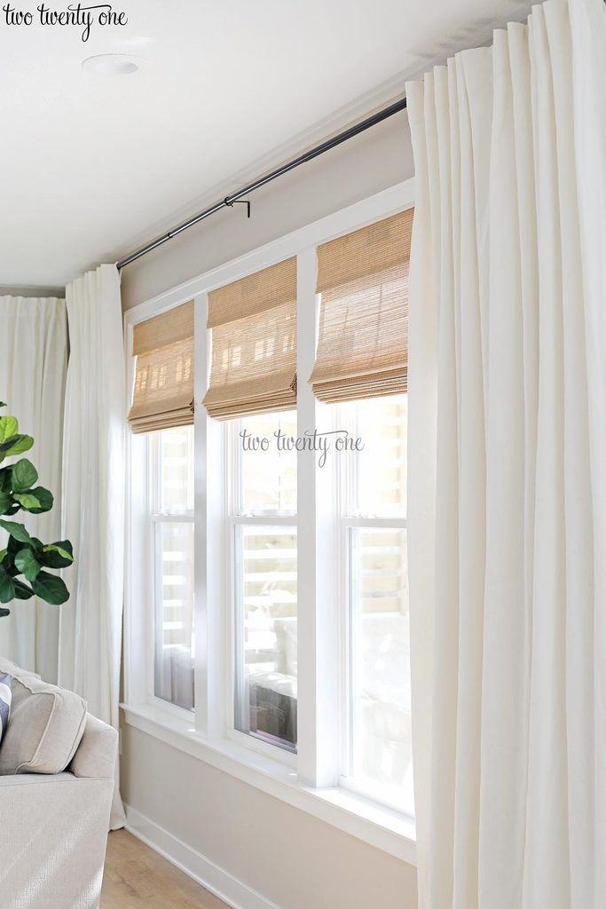 Woven shades with white curtains