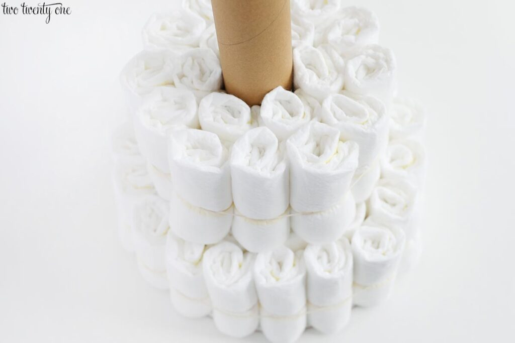 rolled diapers surrounding a cardboard tube