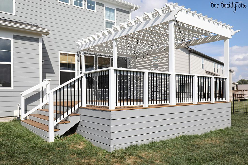 deck with gray base and white pergola