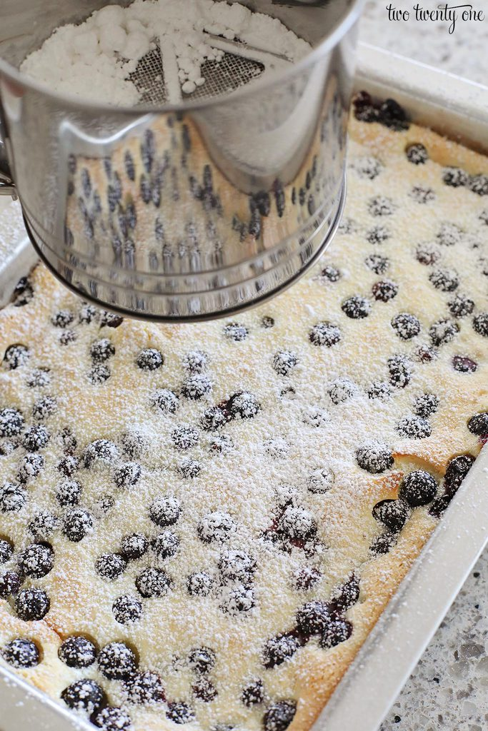 dusting cake with powdered sugar