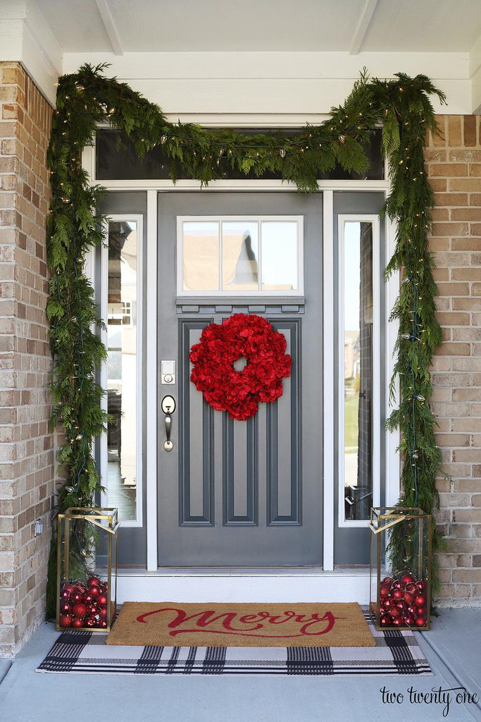 front door decorated for Christmas with garland