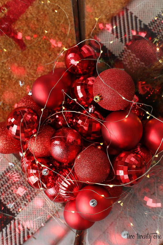 red ornaments with fairy lights