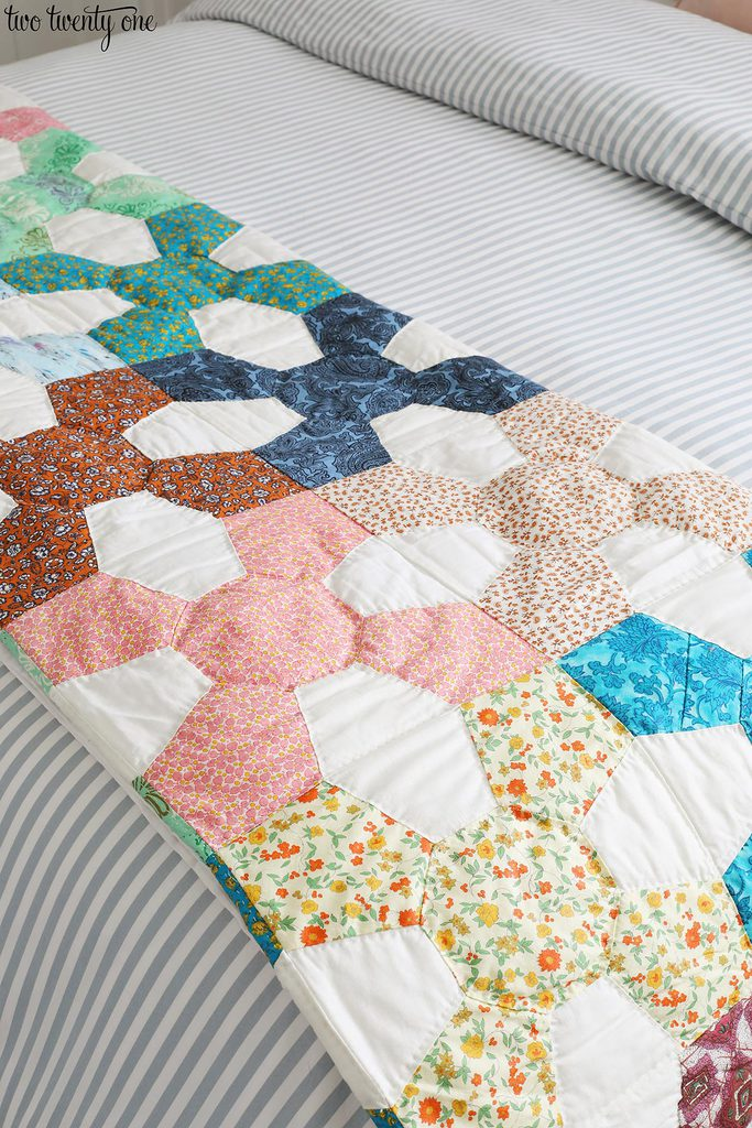 vintage quilt with many colors and patterns