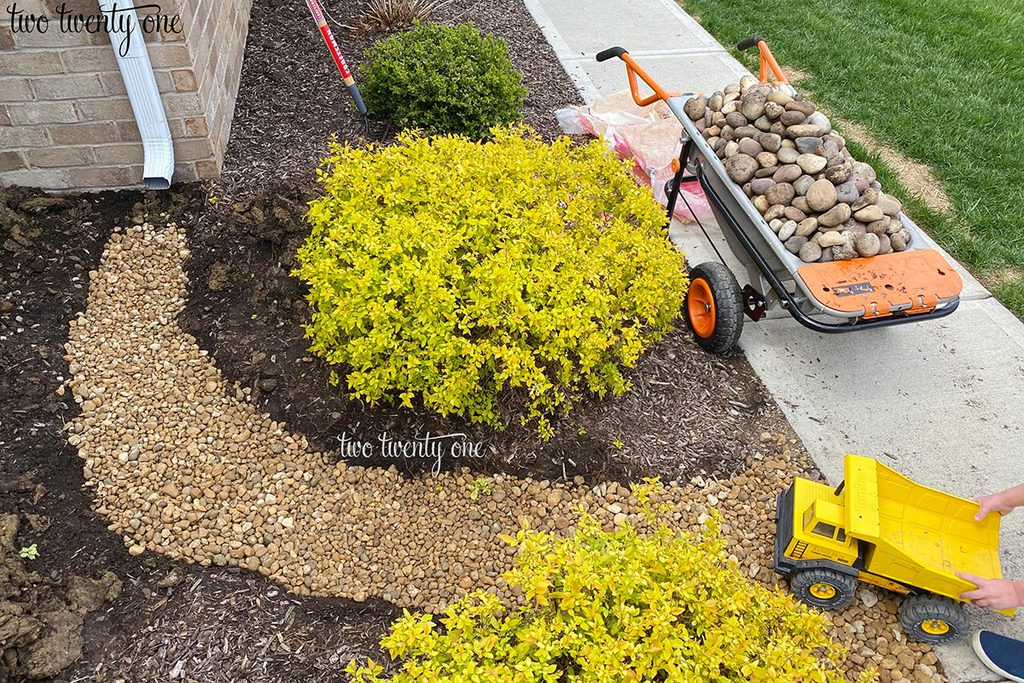 adding gravel to dry creek bed