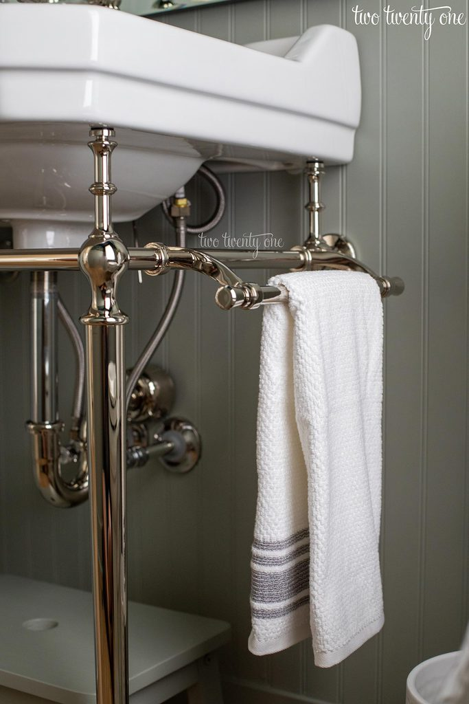 whitehaus victoriahaus console sink in polished nickel with white towel on towel bar