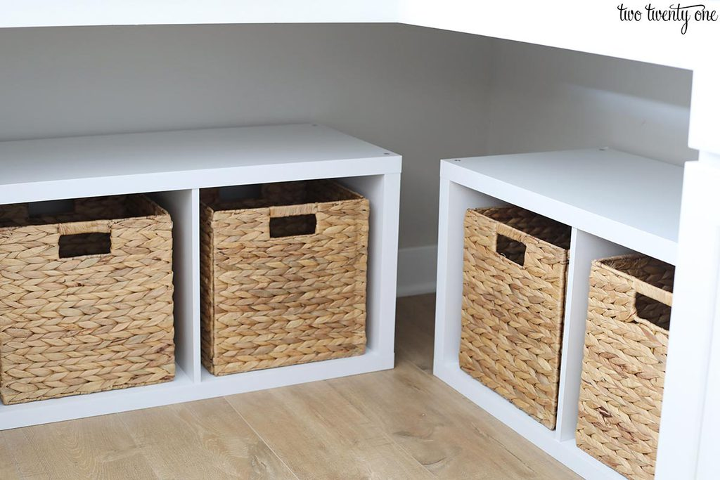 Cube storage shelves with 4 cubes. Hyacinth storage baskets in each cube.