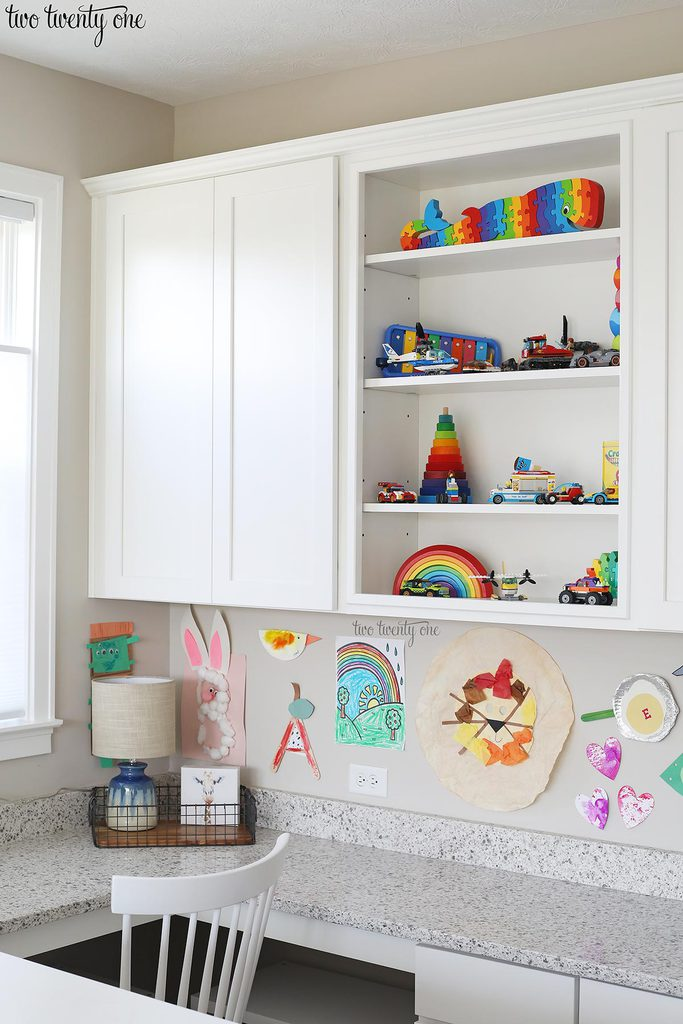 Homework area with wall cabinets and a built-in desk area.