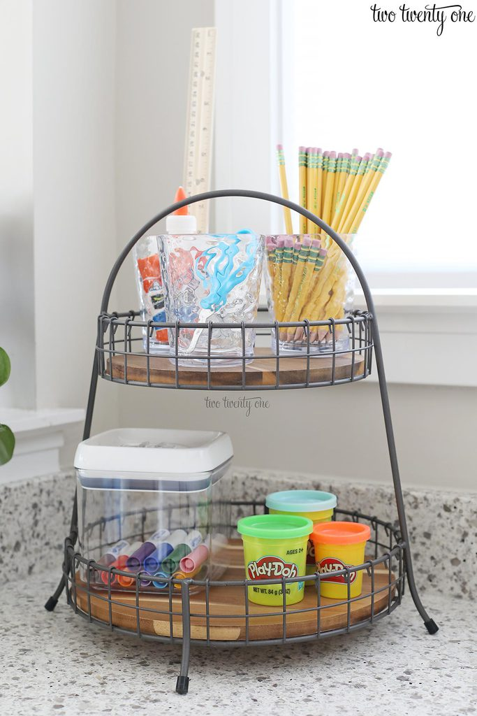 tiered tray with school supplies on it